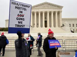 A group among hundreds of supporters of gun control laws rally in front of the US Supreme Court as the justices hear the first major gun rights case since 2010, in Washington, U.S. December 2, 2019. REUTERS/Andrew Chung