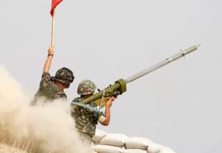 Macedonian soldiers fire an anti-aircraft missile with the Russian-made Igla ground-to-air launcher, supervised by a Slovenian military instructor, during a live fire exercise on September 12, 2008 at the Krivolak training ground, some 120 km (75 miles) s