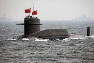 A Chinese Navy nuclear submarine takes part in an international fleet review to celebrate the 60th anniversary of the founding of the People's Liberation Army Navy in Qingdao, Shandong province April 23, 2009. REUTERS/Guang Niu/Pool