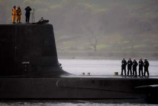 Crew from HMS Astute, the first of the biggest hunter-killer submarines to be ordered by Britain's Royal Navy, look out as they sail into the River Clyde and up the Gareloch to her new home at HM Naval Base Clyde in Faslane near Glasgow, Scotland November