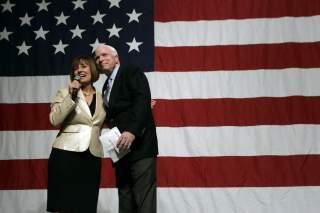 Republican Senate candidate Sharron Angle (L) introduces U.S. Senator John McCain (R-AZ) during a campaign rally at the Orleans hotel-casino in Las Vegas, Nevada October 29, 2010. REUTERS/Las Vegas Sun/ Sam Morris