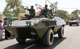 Somaliland troops sit on an armoured personnel carrier during a parade to mark the 22nd anniversary of Somaliland's self-declared independence from the larger Somalia, in Hargeisa May 18, 2013. REUTERS/Feisal Omar (SOMALIA - Tags: ANNIVERSARY POLITICS SOC