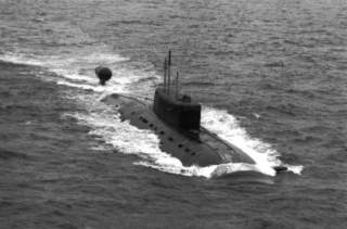 Aerial starboard bow view of a Russian Navy Northern Fleet Sierra II class nuclear-powered attack submarine underway on the surface.