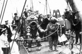 J. Peress' 1-atm dive suit, Tritonia, explored the Lusitania wreck in 1935. Jim Jarrett was Peress's chief diver and made this dive to 312 feet. This suit was a precursor to the