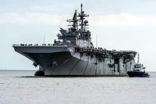 The U.S. Navy amphibious assault ship USS America (LHA-6) returns to Huntington Ingalls Shipyard, Pascagoula, Mississippi (USA), after completing sea trials.