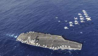 Aircraft assigned to Carrier Air Wing (CVW) 11 perform a fly-by performance for Sailors and their family members on a tiger cruise aboard the aircraft carrier USS Nimitz (CVN 68)