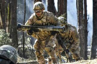A U.S. Army Paratrooper with 2nd Battalion, 503rd Infantry Regiment, 173rd Airborne Brigade carries a AT-4 training grenade launcher    during a platoon level live fire exercise at the 7th Army Training Command's Grafenwoehr Training Area, Germany, March