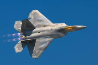 A Lockheed Martin F-22A Raptor fighter streaks by at the 2008 Joint Services Open House (JSOH) airshow at Andrews AFB. Despite many great performances most of those at the show wanted to see the latest USAF fighter. The F-22 did not disappoint!