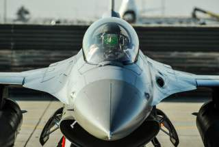 Lt. Col. Thomas Wolfe, the 455th Expeditionary Operations Group deputy commander, performs preflight checks on an F-16 Fighting Falcon at Bagram Airfield, Afghanistan, Feb. 1, 2016. The 421st EFS, based out of Bagram Airfield, is the only dedicated fighte