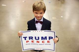 Cole Baird, 8, supporter of Republican presidential nominee Donald Trump, poses for a portrait following a campaign rally in Fredericksburg, Virginia, U.S., August 20, 2016. REUTERS/Carlo Allegri