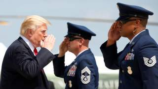 U.S. President Donald Trump returns a salute while boarding Air Force One as he departs Joint Base Andrews in Maryland, U.S., August 30, 2017. REUTERS/Kevin Lamarque