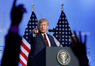 U.S. President Donald Trump takes questions from the media during a news conference after participating in the NATO Summit in Brussels, Belgium July 12, 2018. REUTERS/Kevin Lamarque
