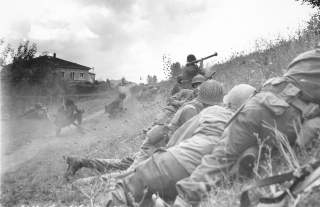 This African-American combat patrol advanced three miles north of Lucca (furthermost point occupied by American troops) to contact an enemy machine gun nest. Here a bazooka-man cuts loose at the target some 300 yards distant. Wikimedia Commons