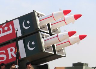 Pakistani military personnel stand beside short-range Surface to Surface Missile NASR during Pakistan Day military parade in Islamabad, Pakistan, March 23, 2017. REUTERS/Faisal Mahmood