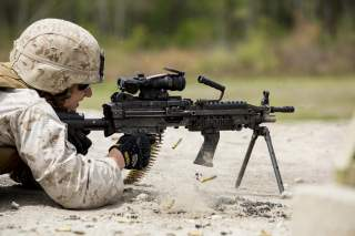 Marine with Alpha Company, 8th Engineer Support Battalion, 2nd Marine Logistics Group fires an M-249 Squad Automatic Weapon during a machine gun shoot aboard Camp Lejeune, N.C., April 14, 2014.