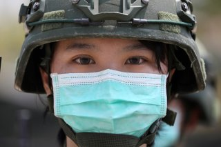 Soldiers with face masks to protect them from coronavirus disease (COVID-19) at a military base camp in Tainan, Taiwan, April 9, 2020. REUTERS/Ann Wang