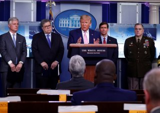 U.S. President Donald Trump addresses the daily coronavirus response briefing as National Security Advisor Robert O'Brien, Attorney General William Barr, Defense Secretary Mark Esper and U.S. Joint Chiefs Chairman Gen. Mark Milley listen at the White Hous