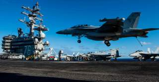 PHILIPPINE SEA (June 20, 2018) An EA-18G Growler assigned to Electronic Attack Squadron (VFA) 141 lands on the flight deck of the Navy's forward-deployed aircraft carrier, USS Ronald Reagan (CVN 76). Ronald Reagan, the flagship of Carrier Strike Group 5,