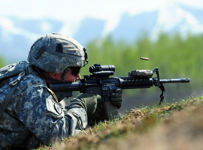 Cpl. Johnny Hurst, assigned to A Company 3rd Battalion (Airborne), 509th Infantry Regiment, a native of Chicago, fires his M4 carbine during a live-fire and movement-to-contact operation on the Infantry Squad Battle Course at Joint Base Elmendorf-Richards