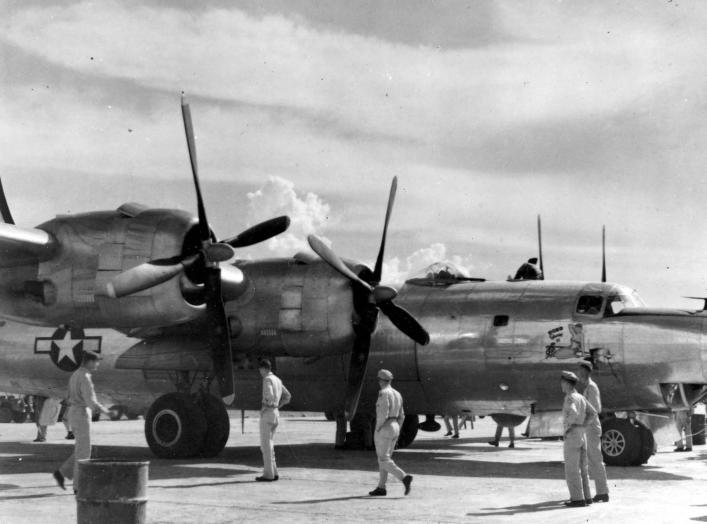 AAF personnel at Clark Field, Philippines, get their first look at a Consolidated B-32 Dominator in May 1945. Comparable to the B-29 in size and performance, B-32s saw service with only one bomber squadron before war's end. (U.S. Air Force photo)