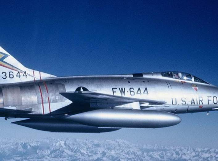 """In 1962, the 20th Fighter Bomber Wing reequipped with North American F-100 Super Sabres like this one, much better suited for the nuclear """"toss bombing"""" mission due to their greater power and speed."""