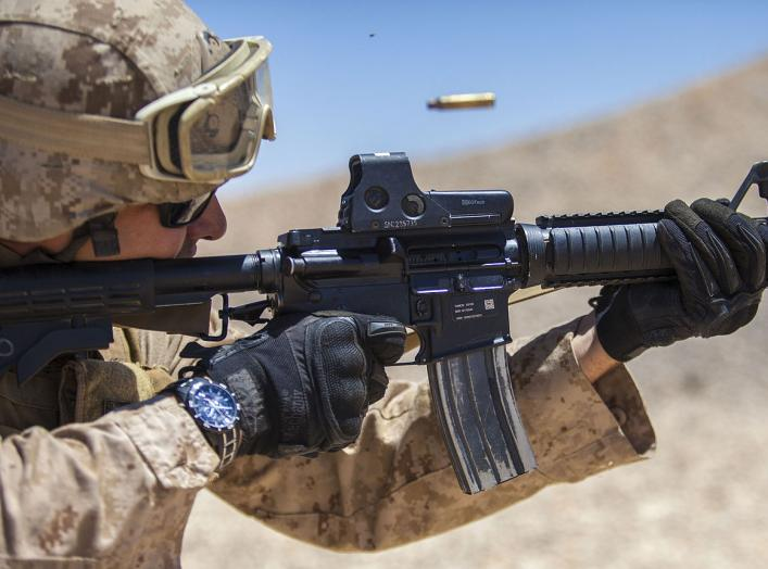 Jordan - A 26th Marine Expeditionary Unit (MEU) Maritime Raid Force Marine fires an M4 Carbine at a range in Jordan, June 19, 2013. Exercise Eager Lion 2013 is an annual, multinational exercise designed to strengthen military-to-military relationships and