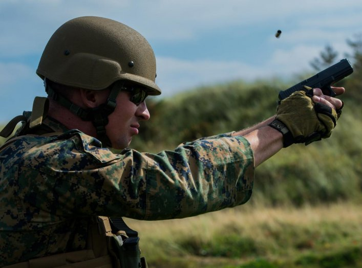 Sgt. Devin Hughes, a member of the Marine Corps Shooting Team, fires a round at a target during the Royal Marines Operational Shooting Competition at Altcar Range near Hightown, England, Sept. 8, 2014. (U.S. Marine Corps photo by Cpl. Cameron Storm/Releas