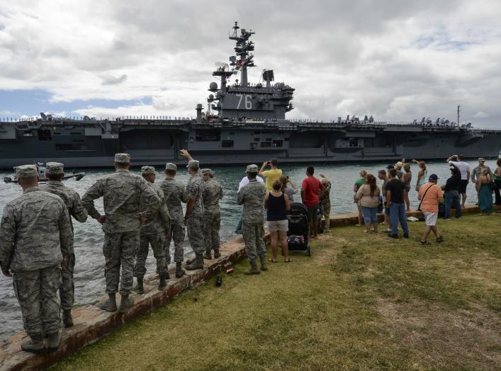PEARL HARBOR (June 26, 2014) Service members and civilians watch as the aircraft carrier USS Ronald Reagan (CVN 76) transits to Joint Base Pearl Harbor-Hickam to participate in the Rim of the Pacific (RIMPAC) 2014 exercise.