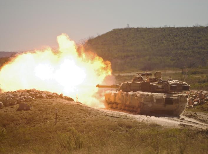 A burst of fire erupts from the muzzle of a 2nd Armored Brigade Combat Team, 1st Cavalry Division M1 Abrams tank during gunnery training at Fort Hood, Texas.