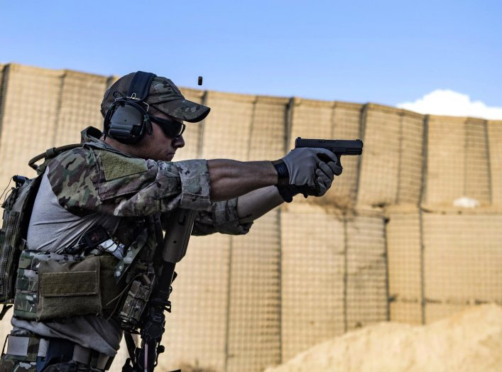 An Air Force pararescueman fires his Glock 9 mm handgun during weapons training at Bagram Airfield, Afghanistan, Feb. 21, 2018. Air Force photo by Tech. Sgt. Gregory Brook