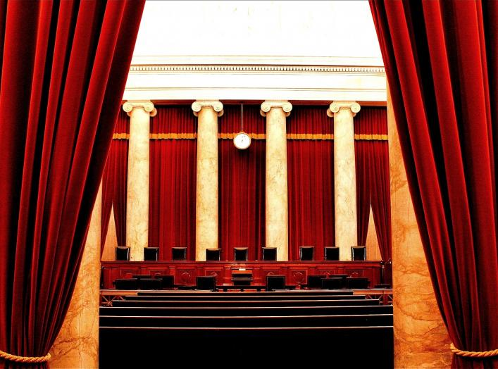 The inside of the United States Supreme Court. In the photo are the nine chairs of the Supreme Court Justices.
