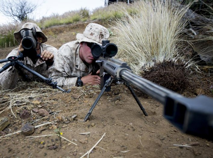 "U.S. Marines attached to Scout Sniper Platoon, Weapons Company, 1st Battalion, 3rd Marine Regiment, ""The Lava Dogs"" pose as a Sniper Spotter team with the M107 .50-caliber Sniper Rifle at Lava Viper aboard Pohakuloa Training Area, Hawaii, June 3, 2015.(U."