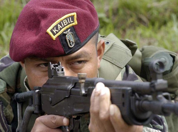 "A Kaibil shows the proper way to fire a Galil assault rifle during an exhibition in the Special Forces Brigade, known as ""Kaibil's Hell"", in Poptun, Peten, October 30, 2006. REUTERS/Carlos Duarte"
