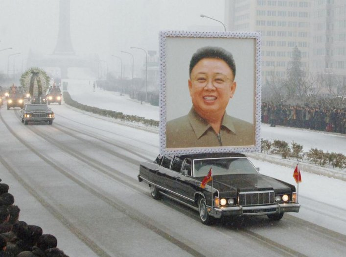 Image: A limousine carrying aportraitof late North Korean leaderKimJong-il leads his funeral procession in Pyongyang in this photo taken by Kyodo December 28, 2011.REUTERS/Kyodo.