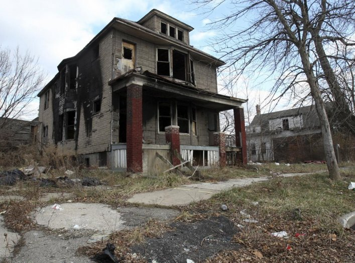 A partially burned, abandoned house is seen in Detroit, Michigan, January 7, 2012. REUTERS/Rebecca Cook.