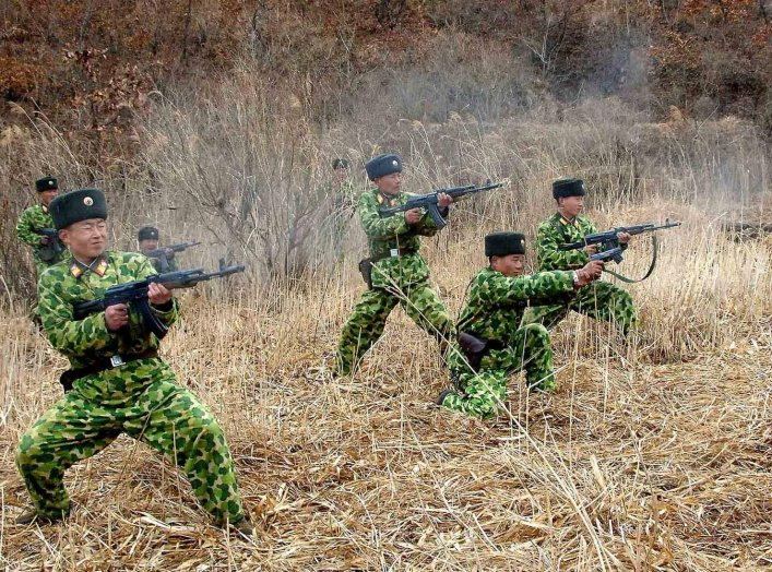 North Korean soldiers with weapons attend military training in an undisclosed location in this picture released by the North's official KCNA news agency in Pyongyang March 11, 2013.