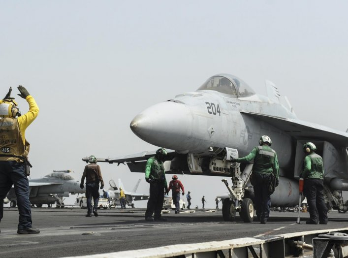 An F/A-18E Super Hornet prepares to launch from the flight deck of the aircraft carrier USS Nimitz in this U.S. Navy handout taken in the Red Sea in this September 3, 2013 handout from the U.S. Navy. Mass Communication Specialist 3rd Class Nathan R. McDon