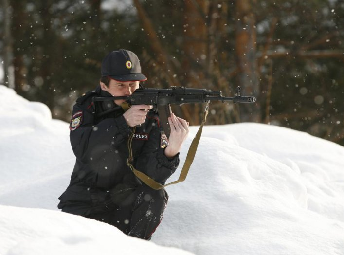 Special task force police officer Irina Samit, who is also an instructor, aims with a Kalashnikov AK-47 rifle as she takes part in a training session in the suburbs of Russia's Siberian city of Krasnoyarsk, March 6, 2014. REUTERS/Ilya Naymushin