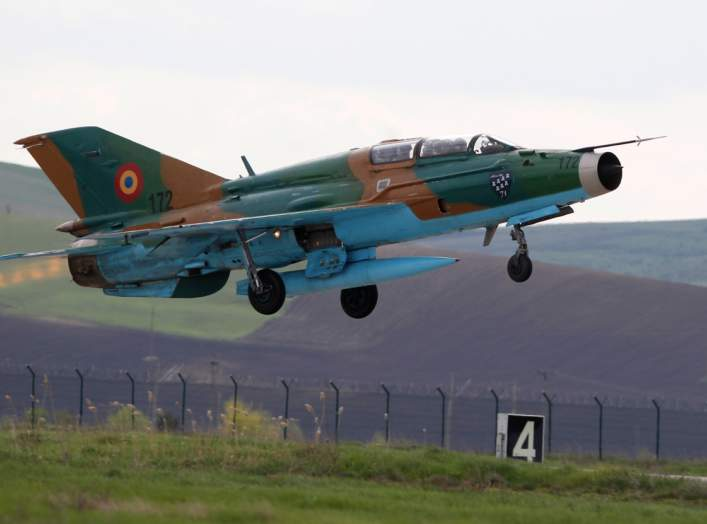"""A MIG-21 Lancer belonging to Romania's Air Force takes off during bilateral one-week training exercises, """"Dacian Viper 2014"""", with U.S. pilots at a military airfield in Campia Turzii in Transylvania, northwest from Romania's northern border with Ukraine,"""