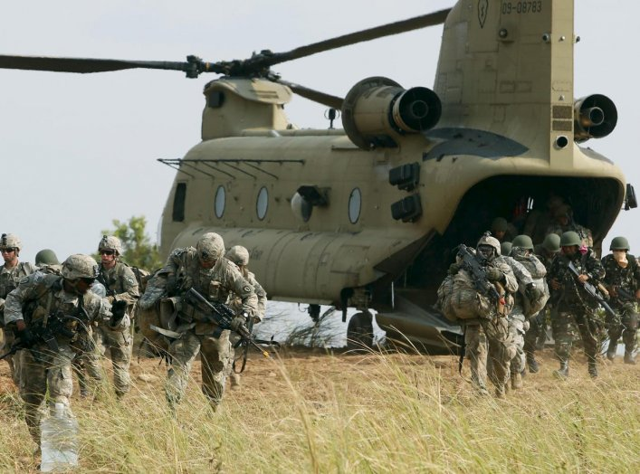 """U.S. soldiers of 2nd Stryker Brigade Combat Team disembark from a U.S. military helicopter CH-47 as they take part in the annual """"Balikatan"""" (shoulder-to-shoulder) war games with Filipino soldiers at a military camp, Fort Magsaysay, Nueva Ecija in norther"""