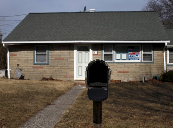 A foreclosed home for sale sits empty in Rochelle Park in Bergen County, New Jersey, March 25, 2015. A surge in bank repossessions of properties in April 2015 pushed overall foreclosure activity across the U.S. to an 18-month high, according to a report b