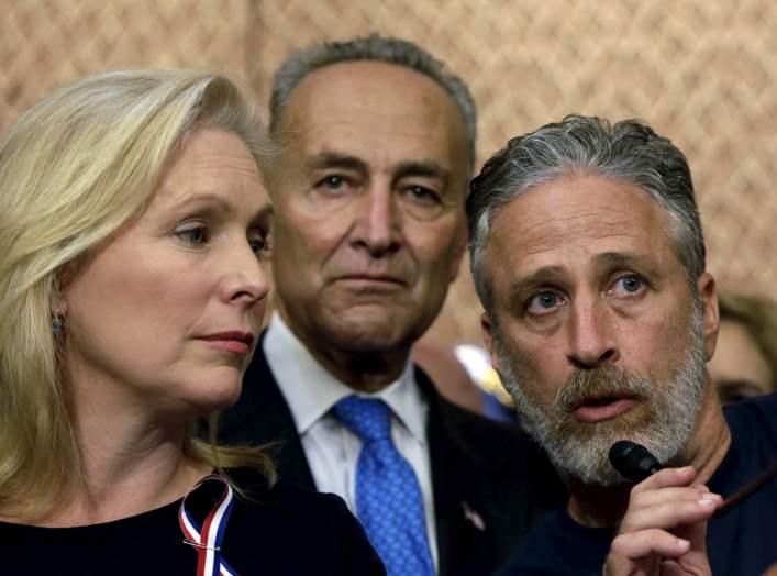 Comedian/director Jon Stewart (R) answers a question at an event to urge U.S. lawmakers to re-authorize the Zadroga Bill at the U.S. Capitol in Washington September 16, 2015. Senators Kirsten Gillibrand (D-NY) (L) and Charles Schumer (D-NY) (C) listen in.