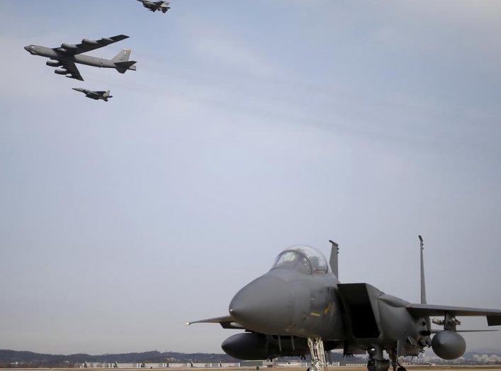 A U.S. Air Force B-52 flies over Osan Air Base in Pyeongtaek, South Korea, January 10, 2016. REUTERS/Kim Hong-Ji