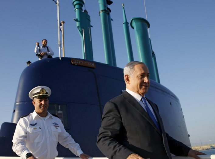 Israeli Prime Minister Benjamin Netanyahu (R) walks on the Rahav, the fifth submarine in the fleet, after it arrived in Haifa port January 12, 2016. REUTERS/Baz Ratner