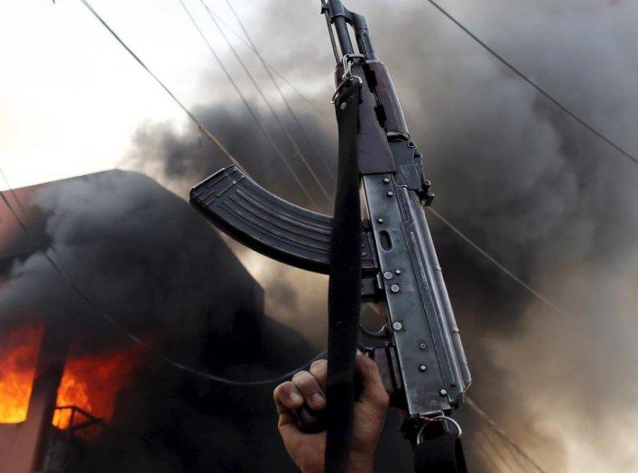 A Kurdish gunman holds a AK-47 rifle in front of a Shi'ite militiaman house during clashes Tuz Khurmato, Iraq, April 24, 2016. REUTERS/Goran Tomasevic