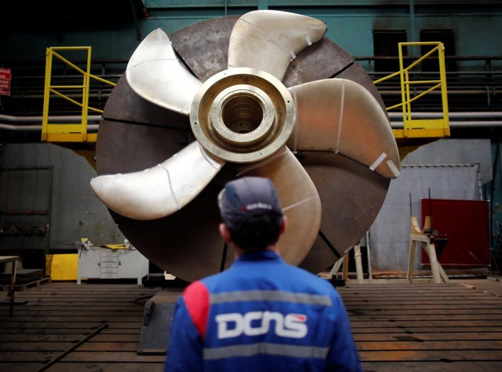 An employee looks at the propeller of a Scorpen submarine at the industrial site of the naval defence company and shipbuilder DCNS in La Montagne near Nantes, France, April 26, 2016. REUTERS/Stephane Mahe TPX IMAGES OF THE DAY