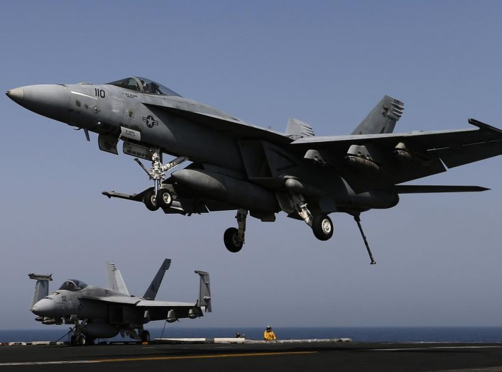 A F/A-18E Super Hornet lands onboard the aircraft carrier USS George H.W. Bush in the Persian Gulf August 12, 2014. REUTERS/Hamad I Mohammed