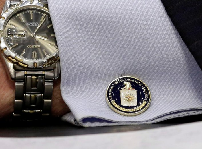 "An cufflink with CIA logo is seen on CIA Director John Brennan's shirt as he testifies before the Senate Intelligence Committee hearing on ""diverse mission requirements in support of our National Security"", in Washington, U.S., June 16, 2016. REUTERS/Yuri"