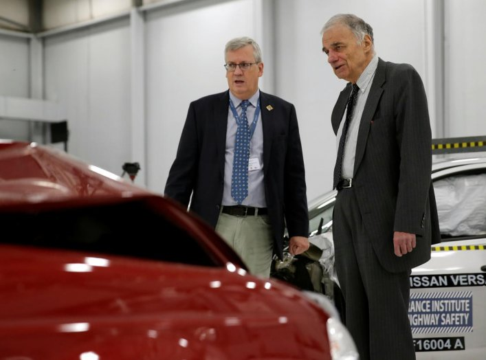 Consumer auto safety advocate Ralph Nader (R) looks over a 2015 Nissan Tsuru (red) after a controlled crash test with a 2016 Nissan Versa at the Insurance Institute for Highway Safety facility in Ruckersville, Virginia U.S., October 27, 2016. REUTERS/Gary