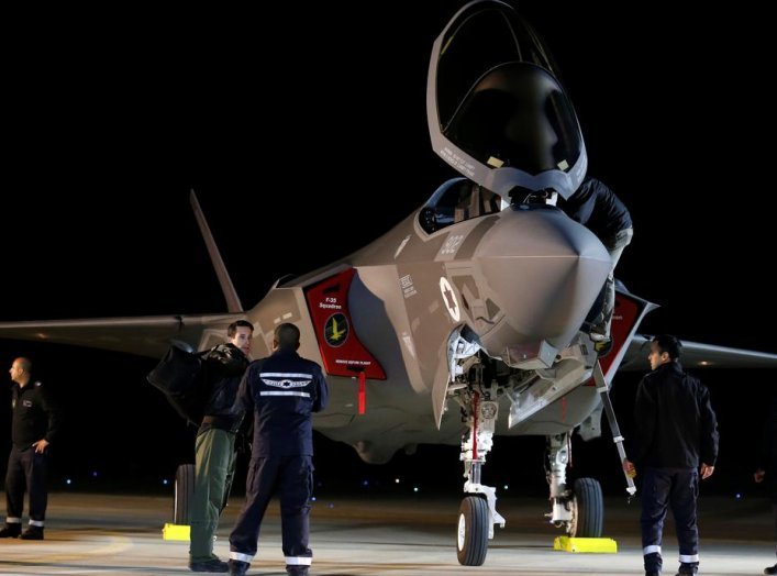 Israeli soldiers walk near a F-35 fighter jet after it landed in Israel at Nevatim air base after the Israeli air force bought them at Nevatim in southern Israel December 12, 2016. REUTERS/Amir Cohen